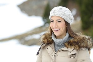 Happy woman posing on winter holiday