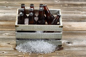 Bottled beer and ice in crate