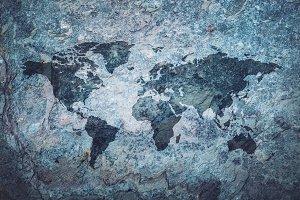World map on grey stone background.