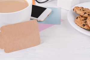 Empty paper card with coffee, phone