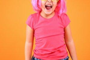 Multicolored little girl screaming