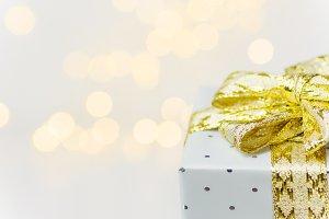 Silver gift box golden bow Christmas