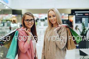 Portrait of beautiful girls holding