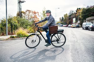 Active senior man with electrobike