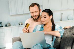 handsome husband holding credit card