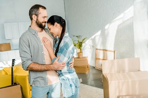 laughing couple embracing while pack
