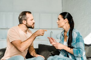 couple having argument and husband y