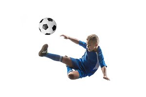 Young boy with soccer ball doing