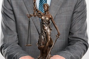 cropped shot of lawyer holding lady