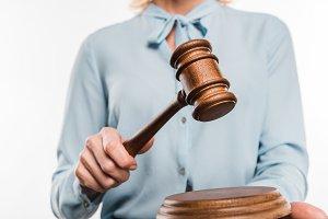 cropped shot of female judge holding