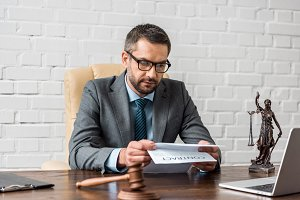 serious male lawyer in eyeglasses wo