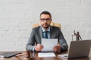 serious lawyer in eyeglasses working