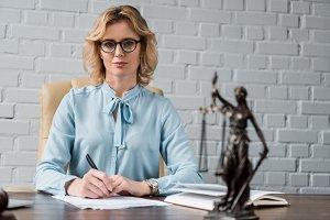 confident female lawyer in eyeglasse