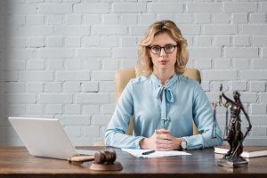 serious female lawyer in eyeglasses