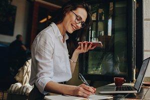 Freelancer at cafe talking on phone