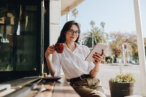 Businesswoman at cafe with cup