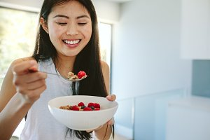 Smiling woman having nutritious