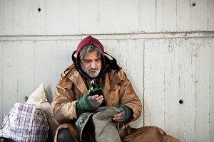 A front view of homeless beggar man