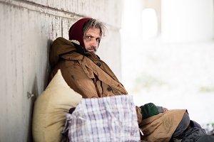 A side view of homeless beggar man