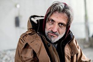 A portrait of homeless beggar man