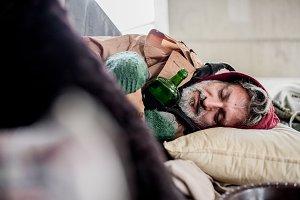 Homeless beggar man with bottle