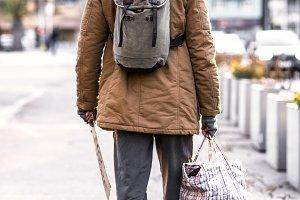 A rear view of homeless beggar man