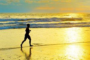 Nab joggiing running beach. Bali