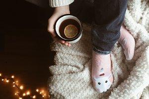 Girl holding tea cup