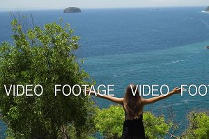 Girl standing on a cliff and looking