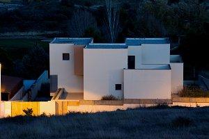 white geometric house at nightfall