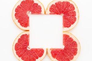 Creative frame of grapefruit slices