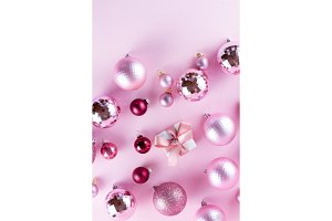 Christmas decorations on pink