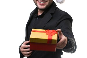 Photo of man in Santa hat with gift
