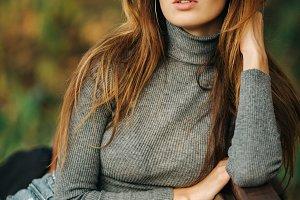 Image of brunette in sunglasses
