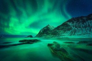 Aurora borealis, snowy mountain