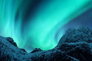 Aurora borealis above mountain peak