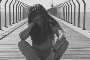 woman sitting on the bridge