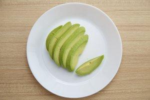 Avocado on white plate Healthy