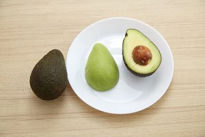Avocado on white plate Healthy