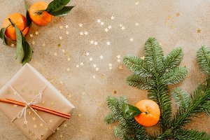 Fir branch, tangerines and a gift