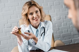attractive female doctor showing jar
