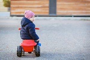Cute little kid boy in warm autumn c