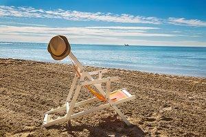 Man in hat relaxing on beach, lookin