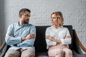 couple sitting on couch after quarre