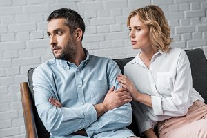 woman talking to husband while sitti