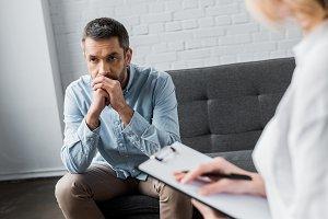 depressed adult man on psychologist