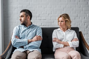 angry couple sitting on couch after