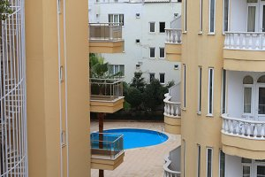 Pool view between hotel buildings