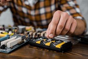 computer engineer taking screwdriver
