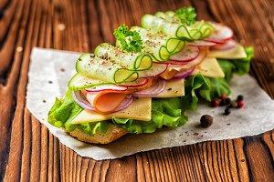 sandwich with ham, cheese, bacon, ra